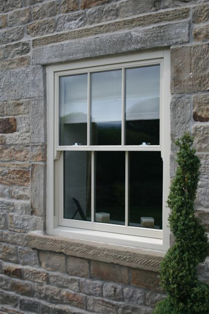 Spiral Balance Vertical Sliding Window