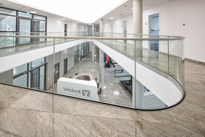 Curved and adjustable glass railing systems for German bank office